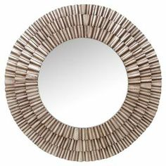 "Wall mirror with a layered sunburst frame in silver.  Product: Wall mirrorConstruction Material: Metal and mirrored glassColor: SilverFeatures:Sunburst frameWill add a touch of contemporary style to any roomDimensions: 41"" Diameter"