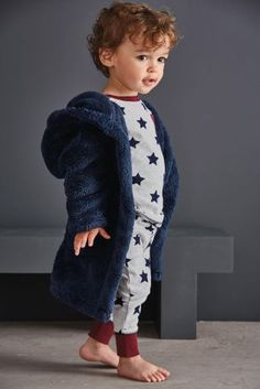 1aa9245ad4e83 Now this little boy looks super adorable and super snug in his navy robe  and star