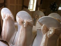 screw the chair covers...i want white lace bows with some beads...pearls and lace