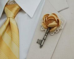 vintage key boutonniere...I would drop the doily, and swap the flower for a peacock feather.