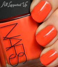 """NARS - TV Party. """"Andy Warhol Color Collection"""" Holiday 2012. A bright orange creme. It's an interesting color choice for a holiday collection."""