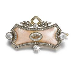 A Fabergé diamond and enamel brooch, workmaster Alfred Thielemann, St Petersburg, 1904-1908, centred with an oval-cut diamond on a convex ground of translucent pale pink enamel over sunburst engine-turning within rose- and circular-cut diamonds, the surmount of tied leaf sprays, struck with workmaster's initials, 56 standard, scratched inventory number 80020 or 89029.