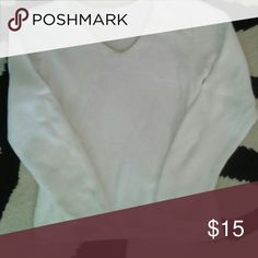 """Beautiful knit  white sweater. Comfy soft knit. V neck. Looks great on. Looks great with white cords I listed. 50% Cotton, 50% Rayon. 17"""" armpit to armpit. 21"""" shoulder to hem. Sweaters V-Necks"""