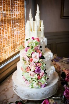 Disney wedding cake with flowers- Wedding Spotlight: Heidi + Tom (Part Two) | Magical Day Weddings | A Wedding Atlas Fan Site for Disney Weddings