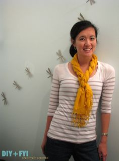A teacher at the school wears her scarves twisted kind of like this and it's really cute. Tutorial here.
