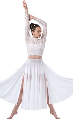 White metallic stretch lace over white lycra and nude mesh crop top with sleeves. Separate white mesh split skirt with attached white lycra booty shorts and metallic lace sash. Made in the USA. M | L | XL | CHILD S | M | L | XL | XXL | ADULT