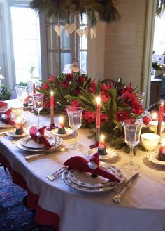 red tulips as centerpiece- santa napkin holders- simple and elegant