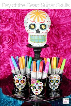 Day of the Dead Sugar Skull DIY. Use colorful markers, adhesive jewels and stickers to decorate these Day of the Dead party decorations.