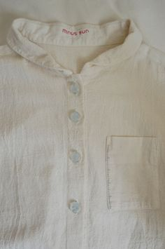 hand drawn graduated breast pocket and handmade resin buttons on calico shirt, minussun