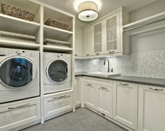 I love how the washer and dryer have pre-built in slots, with built in drawers underneath. Instead of the underneath drawers being a part of the washer and dryer themselves