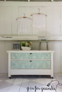 Dresser painted in Fusion's Limestone with vintage wallpapered drawers.