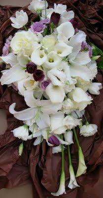 Cascading white bouquet with lavender accents. Google Image Result for http://3.bp.blogspot.com/_x2ZYO9P5u0U/Ss26JSEqyhI/AAAAAAAAAQk/lToRHWf-gFY/s400/white-purple-cascading.jpg