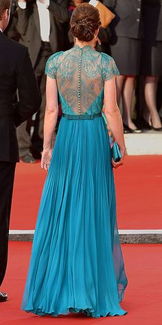 The Duchess of Cambridge continues her racier-than-usual streak in a lovely lace Jenny Packham teal gown with a crystal-embellished waistband, plus a matching teal clutch, saucy metallic sandals and sparkling drop earrings.