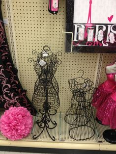 Possible decoration (The white or the metal dress form) for either ...