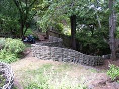 Continuous curved willow fence on uneven ground. Great web site for willow fences.