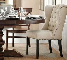 2qty captains chairs with velvet fabric. No studs! Thayer Tufted Wingback Chair #potterybarn