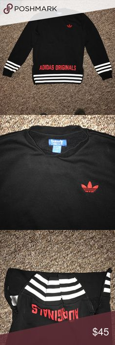 Adidas Original Black Crew Neck Black adidas Crew Neck with red details and white stripes. Zippers on either sides of the hips can be zipped down or left open. For men but I got it for myself even though I am a girl and it's so cute and comfy! Just not my size anymore. Only worn once. Perfect condition. Originally $65. Adidas Sweaters Crewneck