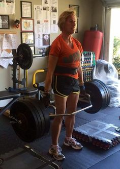 Cage Fighter (52yr old, female marathon runner), hits a 15lb PR with a 310lb trap bar deadlift block pull.   She joins the 300 lb trap bar deadlift block pull club as #2. Awesome work!  #fitness