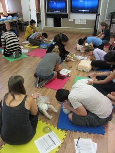 UBC students practice skills they have learned from the Heart & Stroke Foundation's BLS Instructional video.