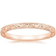 14K Rose Gold Hudson Ring from Brilliant Earth   This stunning antique-style wedding band is adorned with floral-inspired hand engravings and milgrained borders for a refined, romantic style.  Price: $875