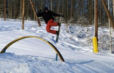 A snowboarder gets some air while enjoying the jumps at Birch Hill's Terrain Park. (Army Photo by SGT Trish McMurphy, USARAK PAO)