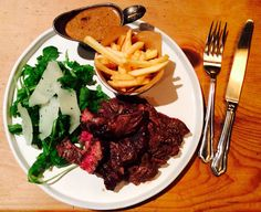 Pre Holiday Dinner of BBQ'd Rib-eye steak with fries, rocket & Pecorino salad and a brandy peppercorn sauce.
