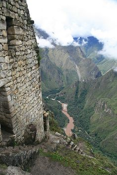 Macchu Picchu and the Urubamba river below. Peru.  images of an Amazing Machu Picchu Trip and Peru Adventures! #bestmachupicchuguides #incaruins #bucketlist