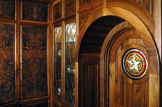 Combined with the leaded glass cabinet panels, this custom woodworking gives a rich and luxurious feel to the home bar. Designed and constructed by Stanton Studios. #custom #woodworking