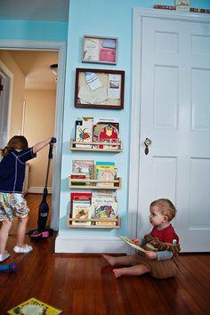 Ikea spice racks as bookshelf -- this looks perfect.