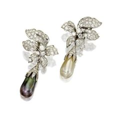 Pair of diamond and cultured pearl pendant-earclips, David Webb. photo courtesy Sotheby's