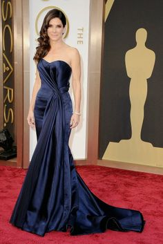 Sandra is channeling old Hollywood glamour in this navy AlexanderMcQueen gown.