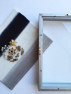 DIY Shadow Box Artwork || Town Lifestyle + Design || See how I turned a few family heirloom jewelry pieces and a fabric memo into a beautiful piece of art.