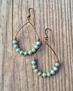 "Copper hoop earrings with turquoise. Light weight, antiqued copper hoops with small turquoise stones and copper accents. Approx 2"" in length."