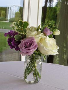 Mason jar arrangement using white and lavender roses and purple stock. Purple Hydrangea Wedding, Purple Flowers, Wedding Flowers, Mason Jar Arrangements, Purple Flower Arrangements, White Roses, White Flowers, Lavender Roses, Light In The Dark