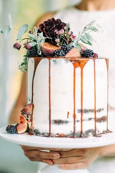 Caramel Drip Cake with Fresh Fruit and Flowers Perfect for a Fall Wedding