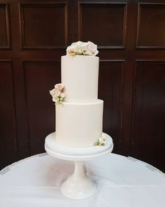 Tall elegant wedding cake with blush and white sugar flowers. Elegant by simplicity. By The Snowdrop Cakery