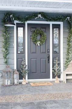 Cozy Farmhouse Christmas Porch Nothing is more nostalgic this time of year than a farmhouse porch all decked out for the holidays! With a few touches of traditional greenery and just a hint of plaid, this cozy farmhouse Christmas porch was so simple to de Front Door Paint Colors, Painted Front Doors, Gray Front Doors, Colored Front Doors, Wooden Front Doors, Front Door Porch, Front Door Decor, Porch Doors, House Doors