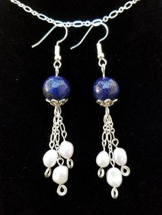 Night Sky Earrings with Lapis Lazuli and Fresh Water Pearls Lapis Lazuli Third Eye and Throat Chakra Unifies the mind and the voice bringing clarity and objectivity of thought and speech. Teaches compassion and spiritual love Fresh Water Pearls Promotes sincerity, truth and