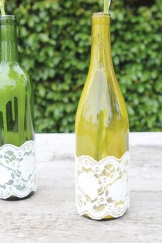 These DIY wine bottle crafts are the cutest ways to repurpose glass vessels. These easy DIYs make for a perfect Christmas project, Mother's Day gift, or just a decor item to keep for yourself—and an excuse to drink wine! Empty Wine Bottles, Wine Bottle Art, Wine Bottle Crafts, Glass Bottle, Bottle Lamps, Diy Bottle, Lace Centerpieces, Wine Bottle Centerpieces, Centrepieces