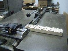 Cutting wood type pieces #letterpress #printmaking