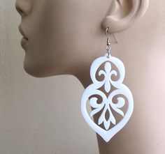 Baronyka Long White Anouk Earrings  These beautiful unique laser-cut earrings are made from white acrylic, they hang on NICKEL FREE Gunmetal plated over brass earwires and measure 3.4 inches tall.  These earrings are lightweight yet substantial.  All of my jewelry comes with a gift box.  $36.9