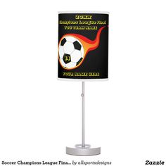 Soccer Champions League Final In Fire Desk Lamps  Custom burning flame soccer ball night lamp with Name of player's, Name of team, Number of jersey and the Year on it. black and yellow lamp with a soccer ball with a orange flame. Background color can be change to team color. The yellow text can be changed as well. This light is great for a gift.Delete any or all text. IMPORTANT Personalize each soccer night light,ONE at a Time, ADD that lamp to the CART