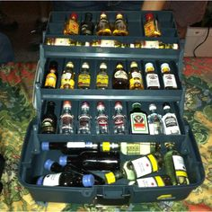 Fishing box filled with mini alcohol...lol how awesome and easy would this be for a gift for the guy you never know what to buy! :)