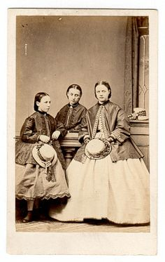 1864 young girls.  Hats and skirts
