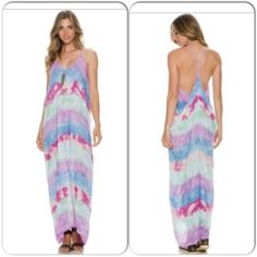 "Tie Dye Maxi Dress Coming Soon This absolutely gorgeous maxi dress features a V neckline and draped Racerback. Easy fit makes it a perfect piece to take on your next tropical getawayAll over tie dye print. Length from shoulder to hem is 55"". 100% rayon.model is 5'10"". Chest 34"", waist 25"", hips 35"" wearing size S/M.  Available in S/M and M/L. Dresses Maxi"