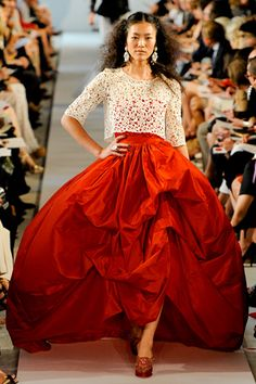 Oscar de la Renta Spring 2012. Fiery red. Beautiful draped dress.
