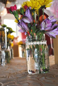 adding lace trim to a mason jar adds the perfect touch!