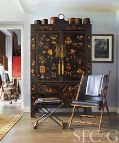 The 1900s Chinese cabinet is from John Rosselli; vintage bamboo and leather chair from Coup d'Etat #SFC&G