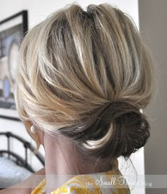 Cute up-do.  pin top half back with bobby pin. then roll the bottom half up and secure on top of the first bobby pin.  widen out the bottom 'poof' and pin some more.
