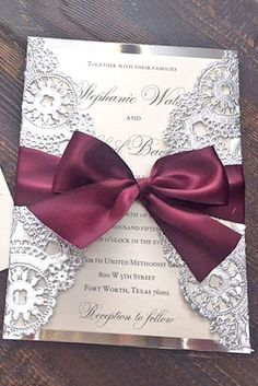LOVE these wedding invites. Very cheap and very easy! Just print your invites on nice card stock, you can find paper doilies at a craft store, paint them silver and pick up some nice dark grey ribbon, assemble & bam - beautiful yet affordable invites!